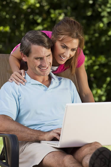 Couple using real estate exam prep tools on computer